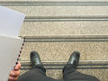 Business man look down to stair holding note book Stock Photos