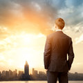 Business man look sunrise in the city Royalty Free Stock Photos