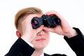Business man is looking through binoculars young Stock Images