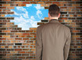 Business Man Looking at Hope Wall Stock Image