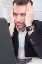 Business man looking at screen laptop computer with a shocked up adult upset expression tired because of work Royalty Free Stock Photo