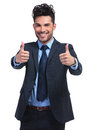 Business man making the ok thumbs up gesture positive young with both hands Royalty Free Stock Image