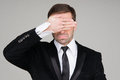 Business man making the see no evil gesture. Businessman coverin Royalty Free Stock Photo