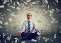 Mature business man meditating under money rain Royalty Free Stock Photo