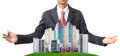 Business man and modern building on green grass field use for land management theme file of Royalty Free Stock Images