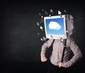 Business man with a monitor on his head cloud system and pointe pointers the screen dark background Royalty Free Stock Photo