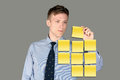 Business man notes using post it Stock Image