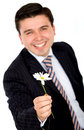 Business man offering a flower Stock Photography