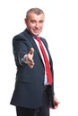 Business man offers handshake mid aged offering you his with a smile on his face isolated on a white background Royalty Free Stock Images