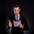 Business man with pad shows ok Royalty Free Stock Photo