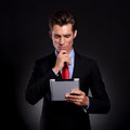 Business man with pad, thinking Royalty Free Stock Photo