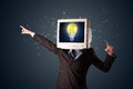Business man with a pc monitor head and idea light bulb in the d Royalty Free Stock Photo