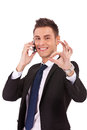 Business man on the phone approving Royalty Free Stock Images