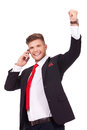 Business man on phone cheers young hearing some good news the and cheering with a big smile his face isolated white background Stock Images