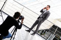 Business man photographer shoots a with phone Stock Photo