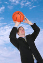 Business Man Playing Basketball Stock Image