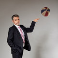 Business man playing with a basketball at the senior businessman getting ready to shoot Royalty Free Stock Photos