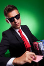 Business man playing with poker face Stock Images