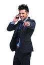 Business man pointing finger while talking on smartphone young his to you his Royalty Free Stock Image