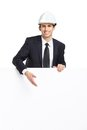 Business man pointing hand gestures at copyspace businessman in white hard hat isolated on white concept of success and Royalty Free Stock Image
