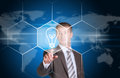 Business man pointing her finger at light bulb Royalty Free Stock Photo