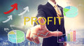 Business man pointing profit with colorful graphs Stock Photography