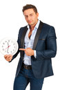 Business man pointing to clock big isolated on white background Stock Image