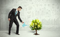 Business man pouring water on lightbulb growing tree Royalty Free Stock Photo
