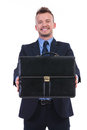 Business man presents his briefcase young presenting with a smile on lips on white background Royalty Free Stock Photos