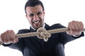 Business man pulling and bond tied with rope  conc Stock Photos