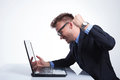 Business man punches his laptop Royalty Free Stock Photo
