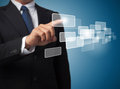 Business man pushing on a touch screen interface Royalty Free Stock Photo
