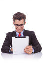 Business man reading on his tablet Royalty Free Stock Photo