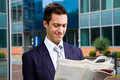 Business man reading a newspaper young Stock Photo