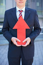 Business man with red arrow Stock Image