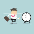 Business man run follow the clock Royalty Free Stock Photo