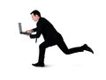 Business man run with laptop isolated Stock Photo