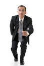 Business man running asian full length isolated on white Stock Photo