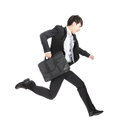 Business man running on isolated white background full length asian model Royalty Free Stock Photo