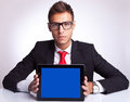 Business man showing an electronic pad Royalty Free Stock Photo
