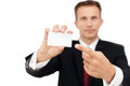 Business man showing his business card happy holding a blank sheet of paper on white to write your text Stock Images