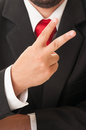 Business man showing number two or peace sign Royalty Free Stock Photo