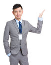 Business man showing something on open palm isolated white Royalty Free Stock Image