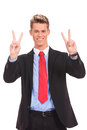 Business man showing two fingers or victory gesture Royalty Free Stock Images