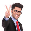 Business man showing victory sign Stock Photo