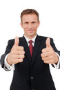 Business man showing you a success sign on white portrait of confident young giving thumbs up isolated against Royalty Free Stock Photo