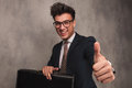 Business man sitting with  briefcase and makes the ok sign Royalty Free Stock Photo