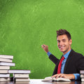 Business man sitting at desk and preparing to write concepts on a blank board with a smile on his face Stock Images