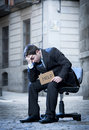 Business Man sitting on Office Chair on Street in stress Royalty Free Stock Photo
