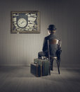 Business man sitting on old chair checking time for his travel Stock Images